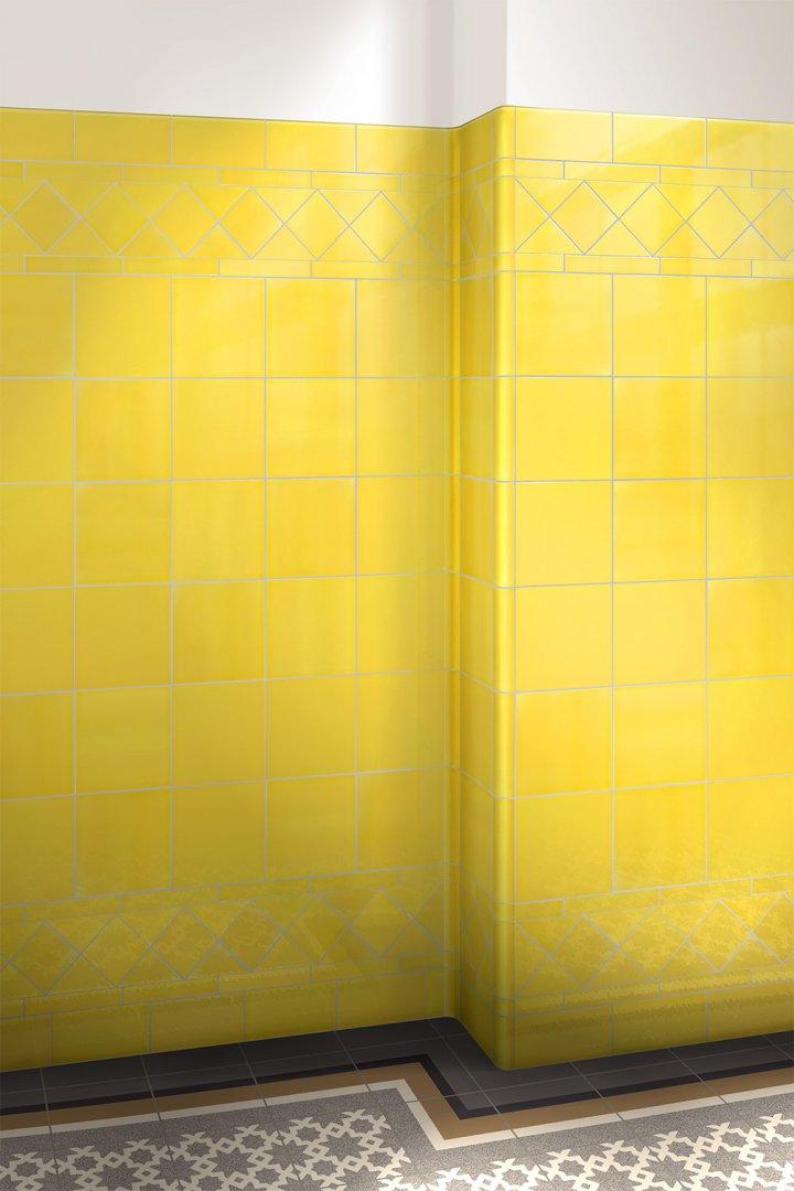 Glasierte Wandfliesen: Einfarbig signalgelb F10.38 in 15x15cm, um die Ecke verlegt.