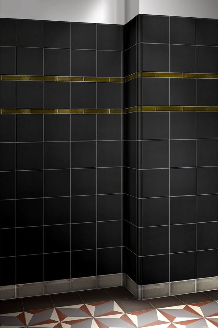 Black matt glazed wall tile F 10.68, with decorative stripes in gray and glossy green.