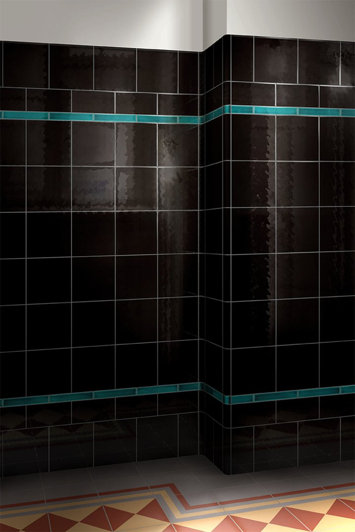 Single-color glazed wall tile F 10.69, black reddish with a slightly reflective surface.