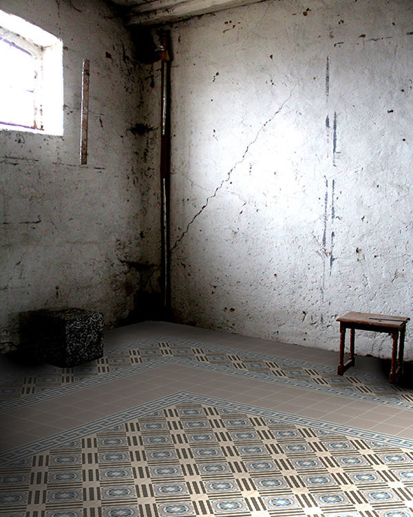 Blue-gray inlaid stoneware tile as a photo construction in an old industrial hall.